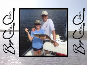 New Orelans Charters Vickey and Jeff with Redfish